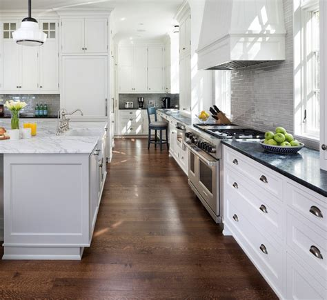 white kitchen with gray island content in a cottage lake house interior ideas home bunch interior design ideas