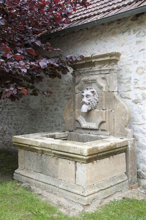 Délicieux fontaine de jardin murale #1: fontaine-murale-jardin-ancienne-pierre-t%C3%AAte-lion.jpg