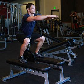 weighted squat exercise  guides bodybuildingcom