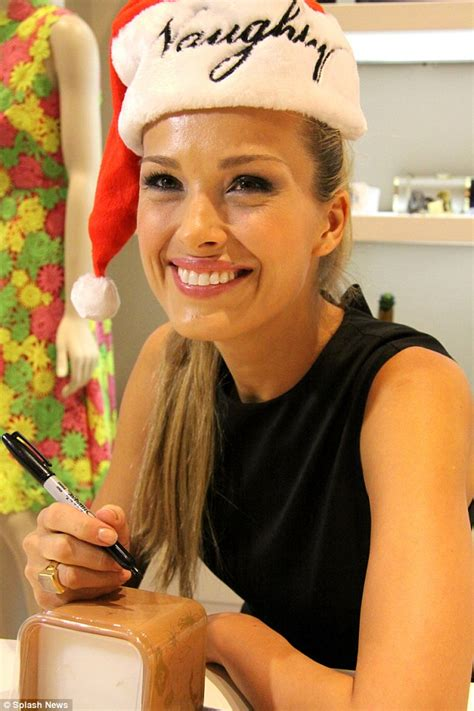 Bergdorf Goodman Home Decor by Petra Nemcova Gets Playful In Santa Hat And Thigh High