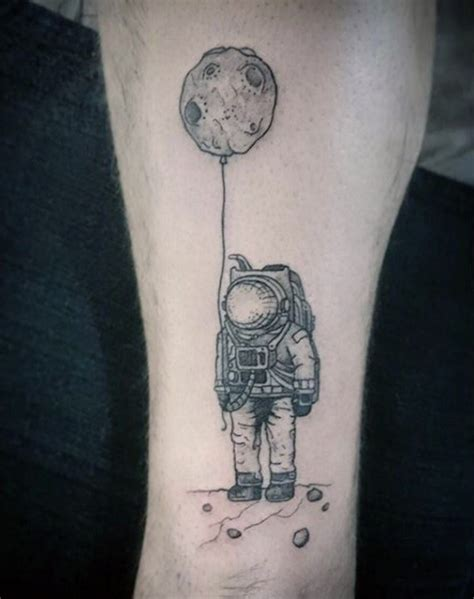 planet ink tattoos like black ink spaceman with planet shaped