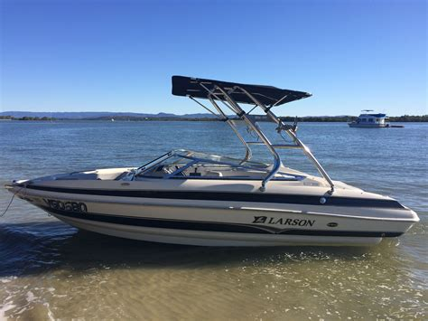 larson boat with a cuda tower and super shadow bimini - Boat Tower Bimini Tops
