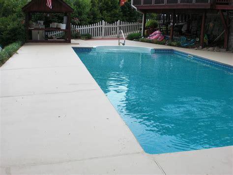 tan pool deck traditional pool   concrete