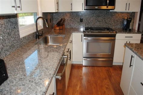 laminate kitchen backsplash caledonia granite tops and backsplash laminate floors