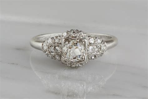 antique platinum edwardian engagement ring with an mine