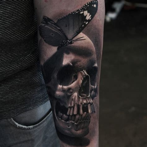 realistic skull tattoo realistic butterfly on skull arm best