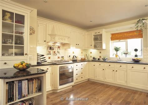cream and black kitchen ideas cream fitted cupboards with black granite worktops in