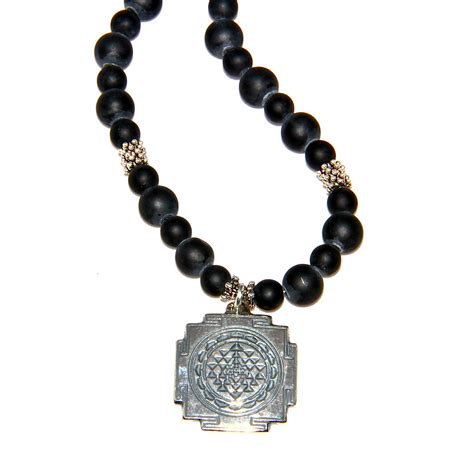 s black onyx sri yantra necklace honoring the sacred