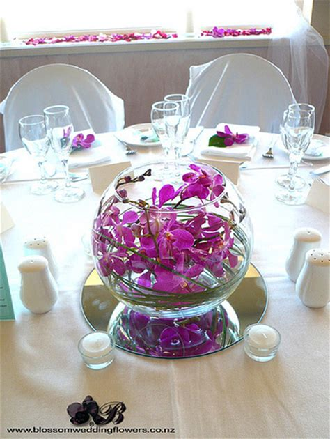 would like to make a small table centerpiece for christmas pink orchid bowl centrepiece wedding reception table flowe flickr