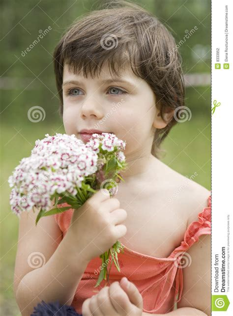 very young little girls teasers portrait of young little cute girl with flower stock
