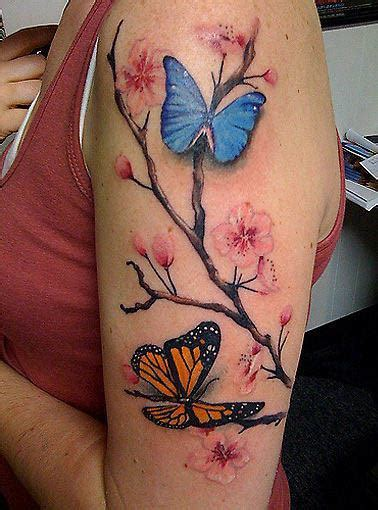 butterfly tattoo cherry blossom a tattoo of a cherry blossom branch and butterflies both