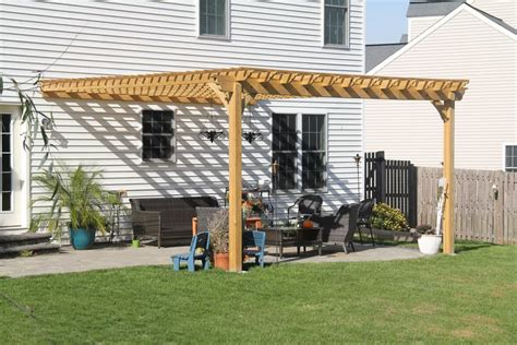 beautiful attached pergola connected to a house in