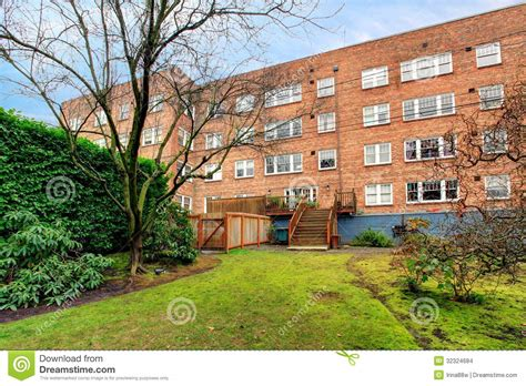 apartments with backyards brick large old apartment building with green spring backyard stock images image