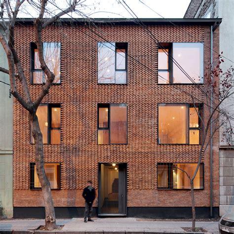 textured front facade modern box home mapa updates chilean housing block with textured brick