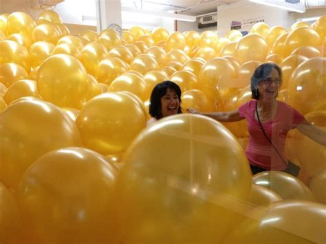 room filled with balloons rooms filled with thousands of balloons cat in water