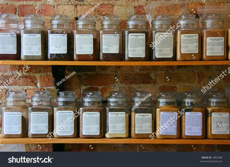 What Is The Shelf Of Dried Spices by Spice Jars On Wooden Shelf On Stock Photo 3382948