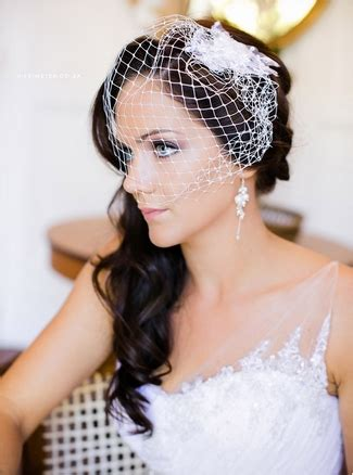 hairstyles to the side with veil vintage wedding birdcage veil inspiration