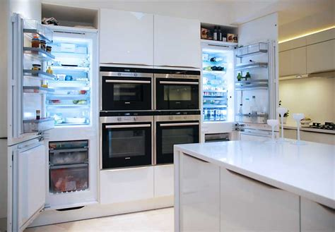 Black Island Kitchen by High Gloss White Kitchen With White Quartz Worktops