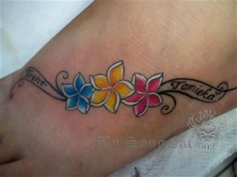 name tattoos with flowers name tattoos on foot s