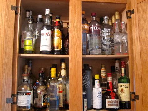 liquor cabinet how to organize your liquor cabinet six twists