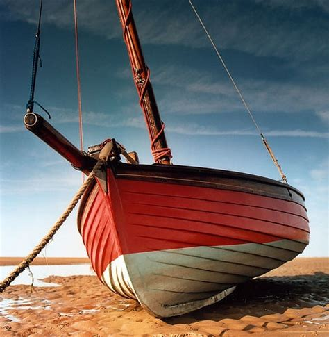 sailboat rope boat rope sand beach docked sailboat red boat painted
