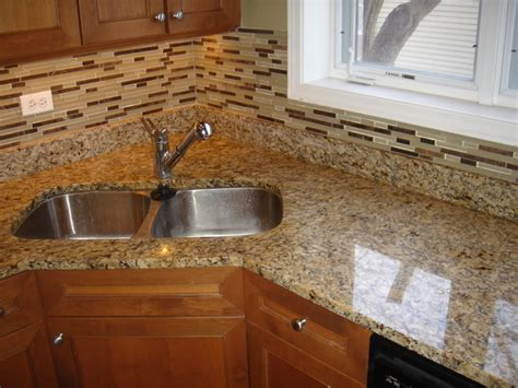granite kitchen backsplash giallo ornamental granite countertop and matching glass