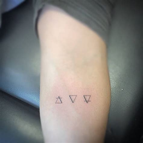 tattoo meaning earth air water and earth alchemy symbol tattoos