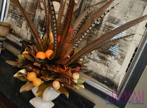 fall centerpieces with feathers a fall centerpiece of magnolia leaves and feathers