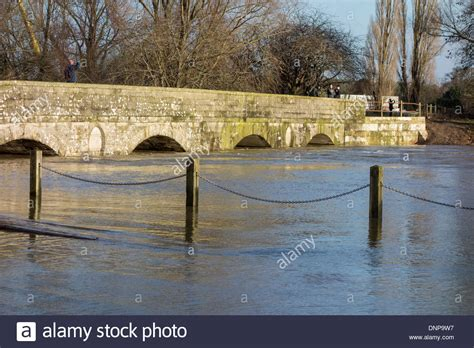 Flood A River S Rage Free Iford Bridge Christchurch And Rising Flood Levels Of The River Stock Photo Royalty Free Image