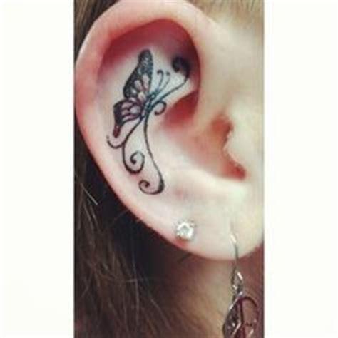 butterfly tattoo inside ear two butterflies on flower ear tattoo tattoomodels tattoo