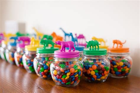 1st Birthday Giveaways Ideas - kara s party ideas animal topped favor jars from a party animal 1st birthday party via