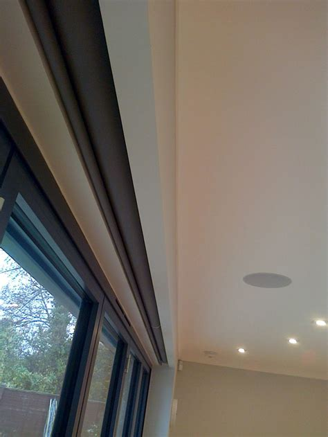Blinds Recessed Into Ceiling - electric blinds covering bifold doors with in a