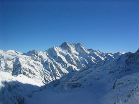 snow images file mountain peaks under snow jpg wikimedia commons