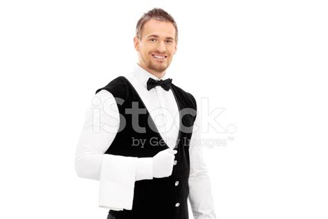 professional waiter with a towel around his arm stock