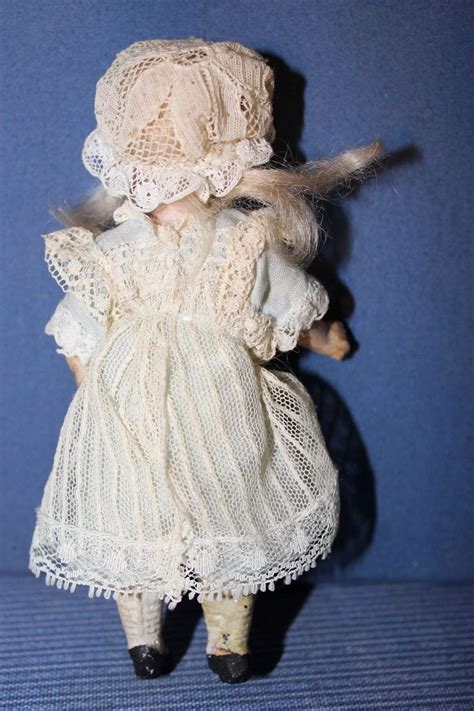 composition doll marked 13 german bisque doll marked 13 composition