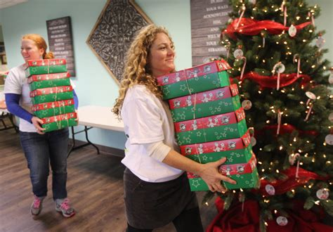 670 shoeboxes family floods donation program with gifts