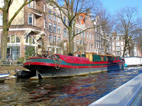 amsterdam house boats guided canal boat tour through the historic city of amsterdam