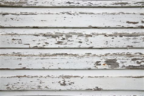 White Wood Wall With Peeling Paint Background And A