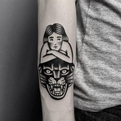 picture of black tattoo with panther head