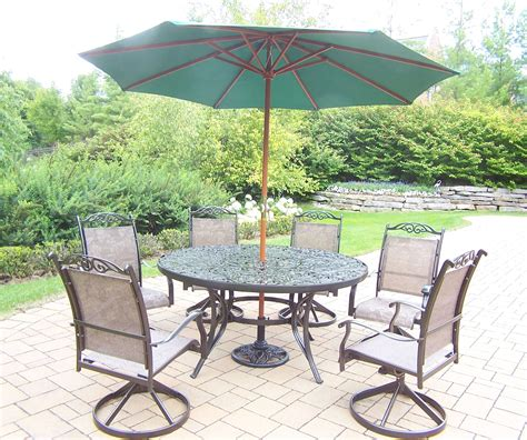 60 patio table set oakland living aluminum patio dining set w 60 quot interchangeable table swivel rockers