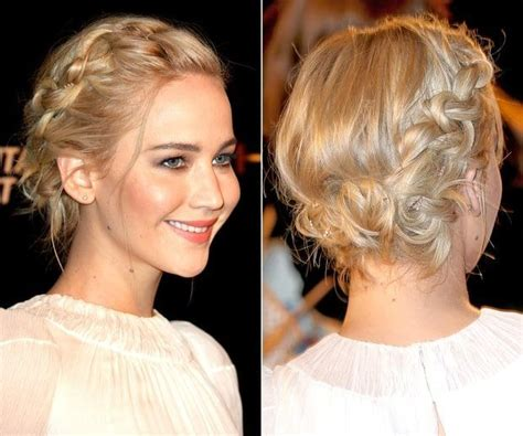 top hairstyles games jennifer lawrence arrives at the hunger games mockingjay