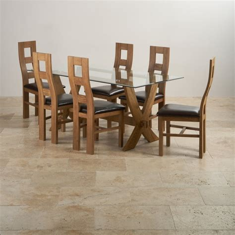 solid oak dining table and 6 leather chairs reflection dining table in rustic oak 6 brown leather chairs