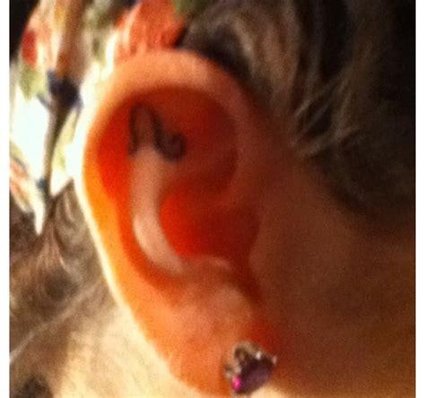 leo tattoo behind ear tiny zodiac tattoo in ear tattooshunt com