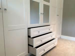 fitted wardrobe with mirror inserts and drawers