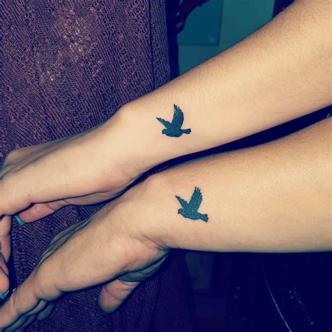 flying birds tattoo on wrist black silhouette flying birds tattoos on wrists