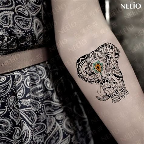 elephant tattoo on arm cool elephant ideas