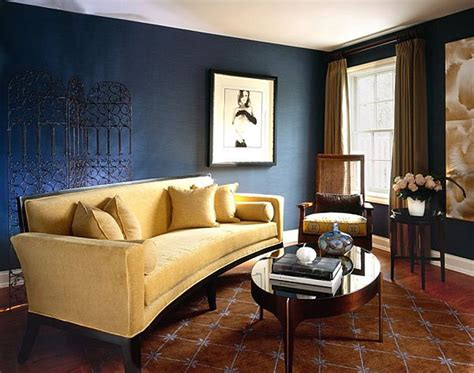 gold sofa brings a bright touch to this brown and blue