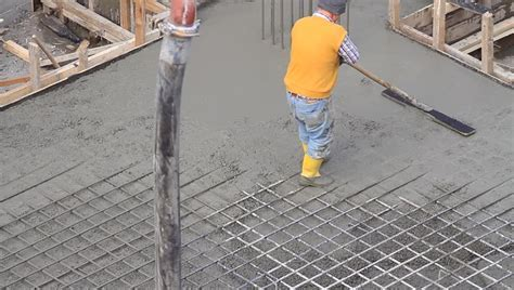 Stock video of concreting and smoothing slab on the