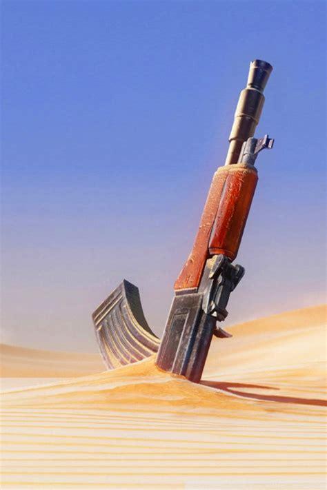 wallpaper for iphone 5 guns gun in sand iphone wallpaper hd