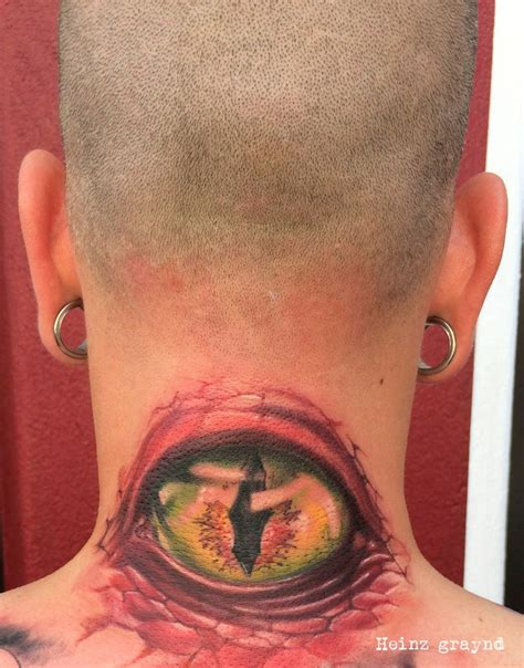 eyeball tattoo on neck eyeball tattoo on the back of the neck by graynd